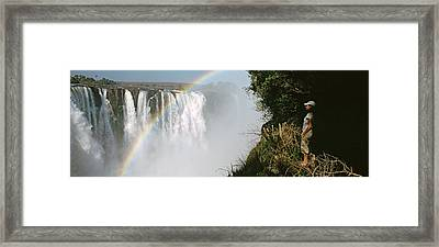 Woman Looking At A Rainbow Framed Print by Panoramic Images