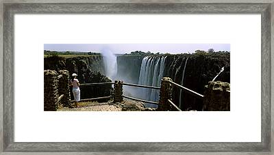 Woman Looking At The Victoria Falls Framed Print by Panoramic Images