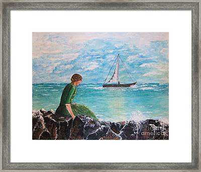 Woman Looking Out To Sea Framed Print