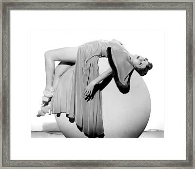 Woman Lying On Exercise Ball Framed Print by Underwood Archives