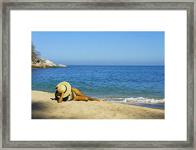 Woman Lying On The Beach Framed Print by Aged Pixel