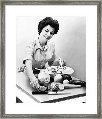 Woman Making A Salad Framed Print by Underwood Archives