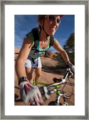 Woman Mountain Biking, Moab, Utah Framed Print