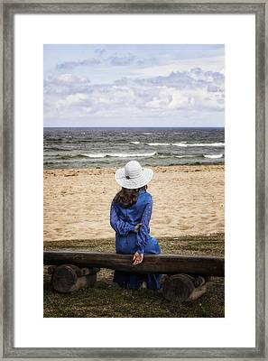 Woman On A Bench Framed Print
