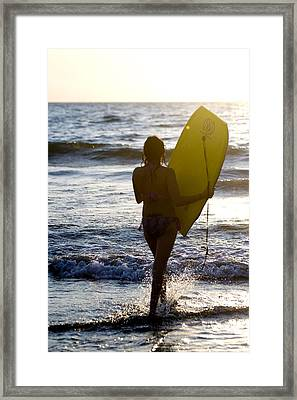 Woman On Beach Carrying Bodyboard Framed Print by Keith Levit
