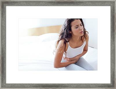 Woman On Bed With Cramps Framed Print
