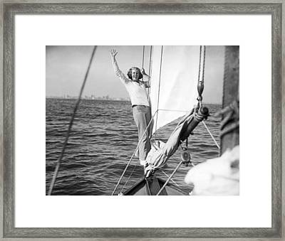 Woman On Bow Sprit Of Sailboat Framed Print