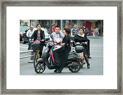 Woman On Electric Scooter In Traffic Framed Print