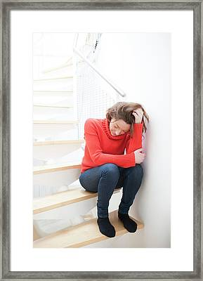 Woman On Staircase Framed Print