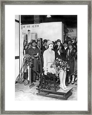 Woman On Vibrating Chair Framed Print