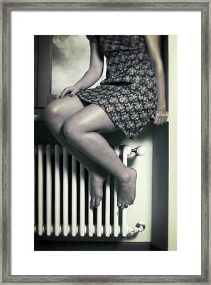 Woman On Window Sill Framed Print
