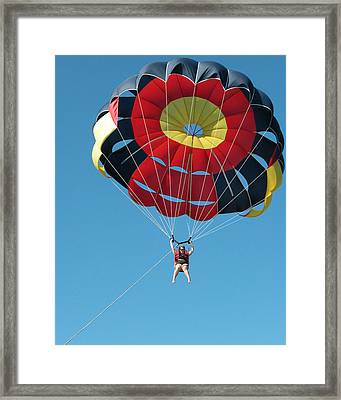 Woman Parasailing Framed Print by Rob Huntley