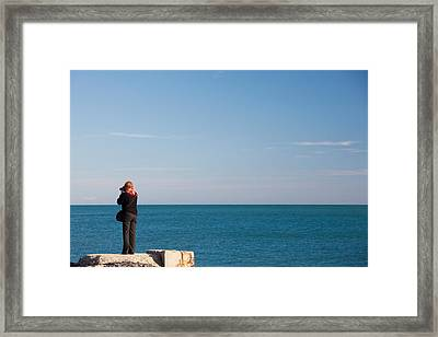 Woman Photographing With A Camera At Le Framed Print by Panoramic Images
