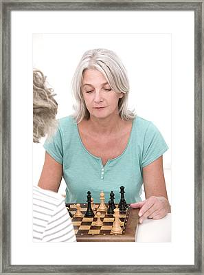 Woman Playing Chess Framed Print by Lea Paterson