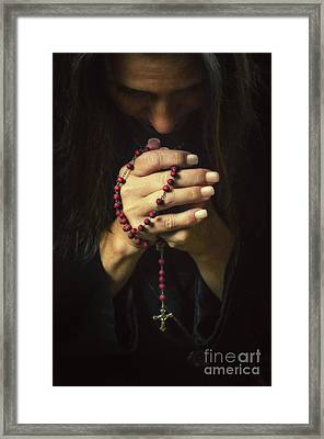 Woman Praying Framed Print by Carlos Caetano
