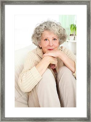 Woman Resting With Her Chin On Hands Framed Print