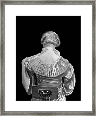 Woman Rubbing Her Neck Framed Print