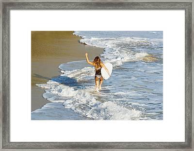 Woman Running Along Beach Framed Print by Ben Welsh