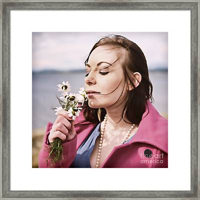 Woman Scenting Daisies Framed Print by Craig B