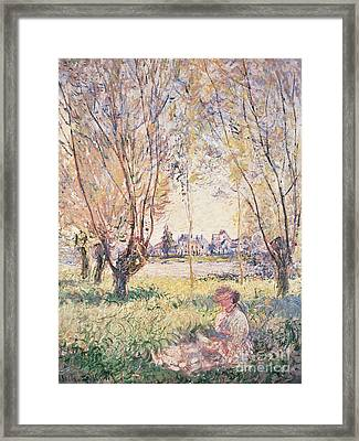 Woman Seated Under The Willows Framed Print by Claude Monet