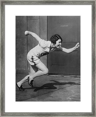 Woman Sprinter Practicing Framed Print by Underwood Archives