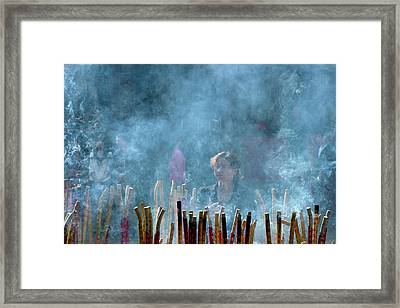Woman Standing In Front Of Incense Burner Framed Print by Tony Camacho
