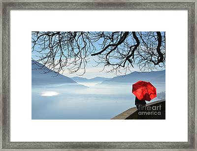 Woman Standing With A Red Umbrella Framed Print by Mats Silvan