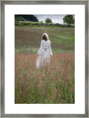 Woman Stands On A Meadow Framed Print by Maria Heyens