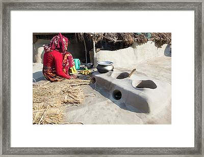 Woman Subsistence Farmer Cooking Framed Print
