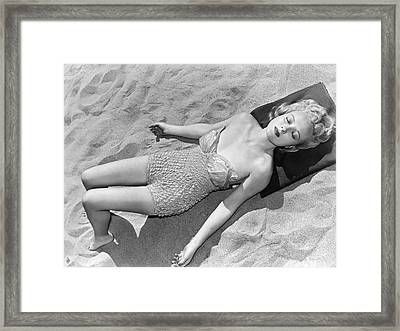 Woman Sun Bathing At The Beach Framed Print