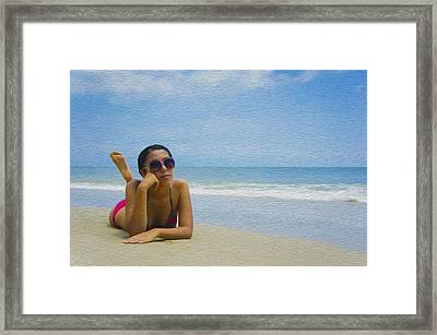 Woman Sun Tanning Framed Print by Aged Pixel