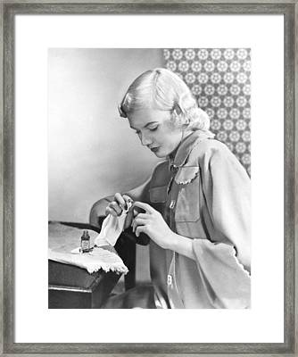 Woman Taking Care Of Her Nails Framed Print