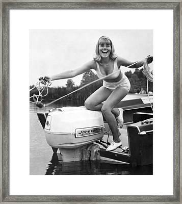 Woman Throwing A Boat Line Framed Print by Underwood Archives