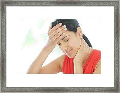 Woman Touching Her Head And Neck Framed Print