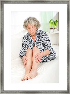 Woman Touching Her Legs Framed Print