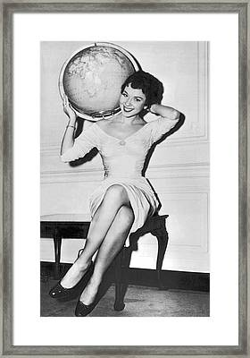 Woman Travels Around The World Framed Print by Underwood Archives
