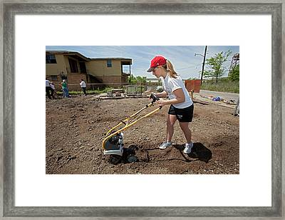 Woman Using A Rotovator Framed Print by Jim West