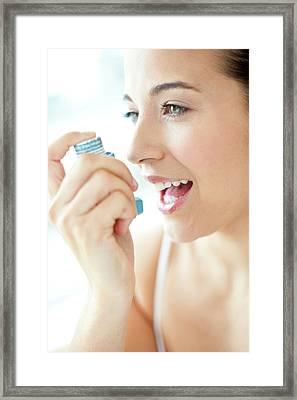 Woman Using An Inhaler Framed Print by Ian Hooton