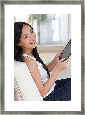 Woman Using Digital Tablet Framed Print by Ian Hooton