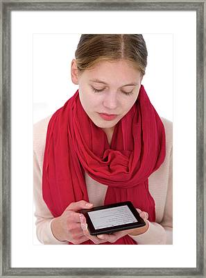 Woman Using E-reader Framed Print by Lea Paterson