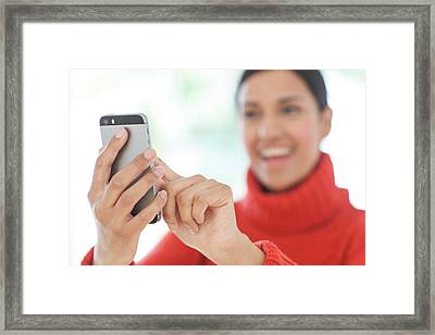 Woman Using Smartphone Framed Print by Ian Hooton