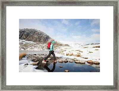 Woman Walker And Frozen Stickle Tarn Framed Print by Ashley Cooper
