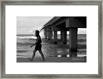 Woman Walking Framed Print by Andres LaBrada