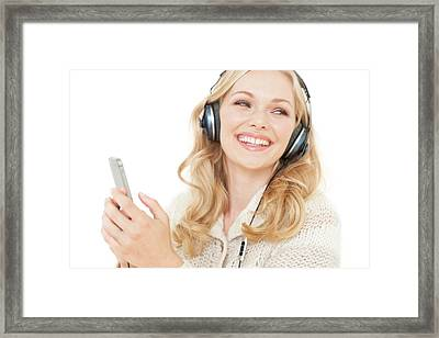 Woman Wearing Headphones With Smartphone Framed Print by Ian Hooton
