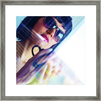 Woman Wearing Sunglasses With Coffee Cup Framed Print