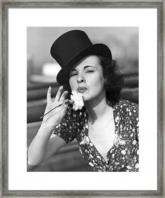 Woman With Carnation Kiss Framed Print by Underwood Archives