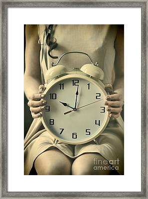 Woman With Clock Framed Print
