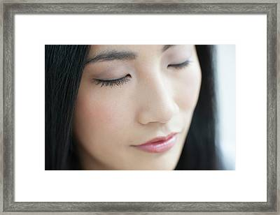 Woman With Eyes Closed Framed Print by Ian Hooton