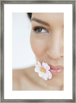 Woman With Flower Framed Print by Ian Hooton/science Photo Library