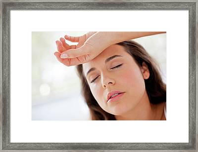 Woman With Hand On Forehead Framed Print